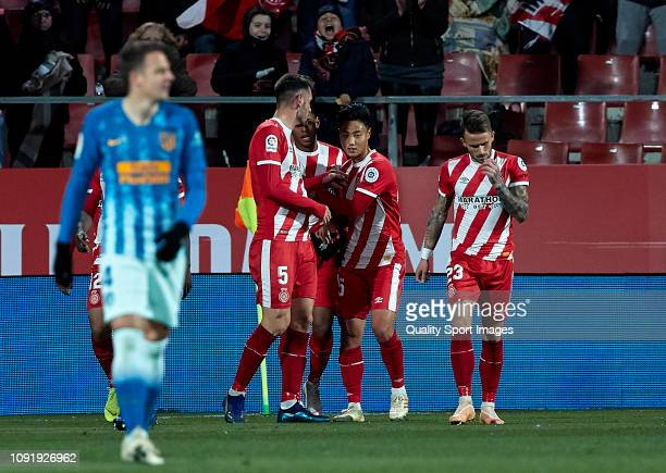 Girona FC players celebrating their teams goal during the Copa del Rey Round of 16 match between Girona FC and Atletico de Madrid at Montilivi...