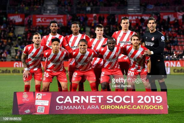 Girona FC players pose for a team picture during the Copa del Rey Round of 16 match between Girona FC and Atletico Madrid at Montilivi Stadium on...