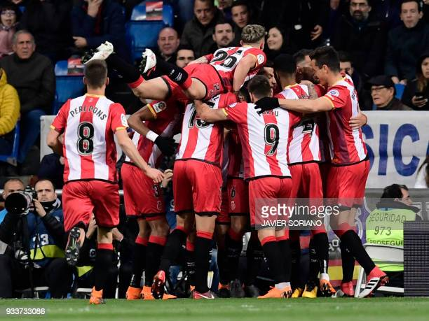Girona players celebrate a goal during the Spanish League football match between Real Madrid CF and Girona FC at the Santiago Bernabeu stadium in...