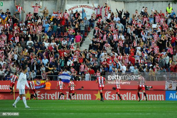 Girona players celebrate their goal with their supporters during the Spanish La Liga football match Girona FC vs Real Madrid CF at the Municipal de...