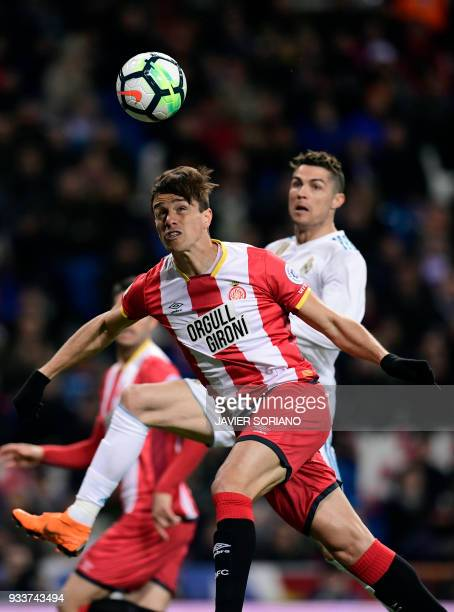 Girona's Colombian defender Bernardo Espinosa vies with Real Madrid's Portuguese forward Cristiano Ronaldo during the Spanish League football match...
