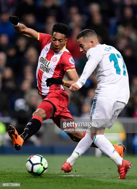 Girona's Colombian defender Johan Mojica vies with Real Madrid's Spanish midfielder Lucas Vazquez during the Spanish League football match between...