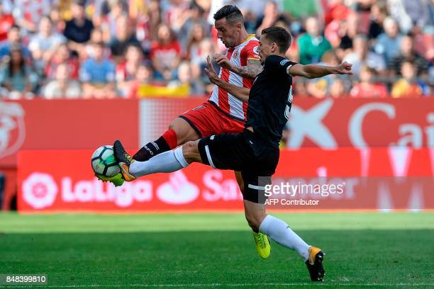 Girona's defender Aday Benitez vies with Sevilla's French defender Clement Lenglet during the Spanish league football match Girona FC vs Sevilla FC...