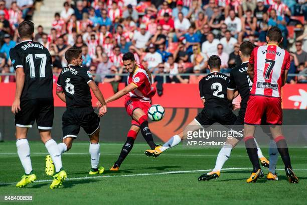 Girona's defender Juanpe Ramirez shoots the ball during the Spanish league football match Girona FC vs Sevilla FC at at the Municipal de Montilivi...