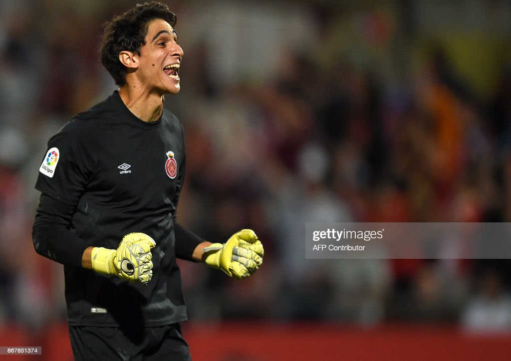 Girona's Moroccan goalkeeper Yassine Bounou celebrates his team's win at the end of the Spanish league football match Girona FC vs Real Madrid CF at the Municipal de Montilivi stadium in Girona on October 29, 2017. / AFP PHOTO / Josep LAGO