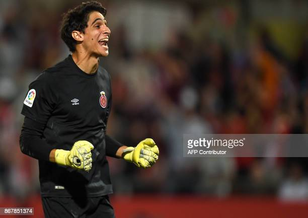 Girona's Moroccan goalkeeper Yassine Bounou celebrates his team's win at the end of the Spanish league football match Girona FC vs Real Madrid CF at...