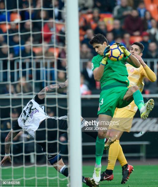 Girona's Moroccan goalkeeper Yassine Bounou stops a shot on goal during the Spanish league football match between Valencia and Girona at the Mestalla...