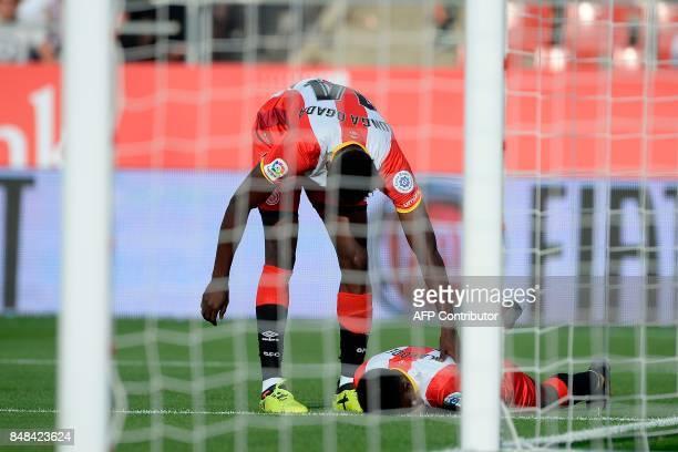 Girona's Nigerian forward Larry Kayode lies on the field during the Spanish league football match Girona FC vs Sevilla FC at at the Municipal de...