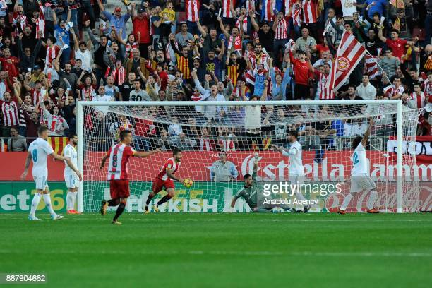 Girona's players celebrate their goal during the Spanish league football match Girona FC vs Real Madrid CF at the Municipal de Montilivi stadium in...
