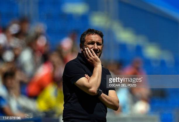 Girona's Spanish coach Eusebio Sacristan stands on the sideline during the Spanish league football match between Getafe CF and Girona FC at the Col...