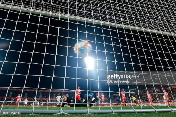 Girona's Spanish goalkeeper Gorka Iraizoz concedes a second goal during the Spanish Copa del Rey quarterfinal second leg football match between...