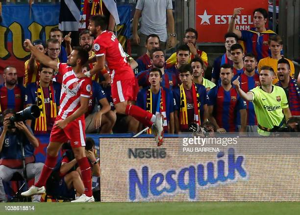 Girona's Uruguayan forward Cristhian Stuani celebrates a goal during the Spanish league football match between FC Barcelona and Girona FC at the Camp...