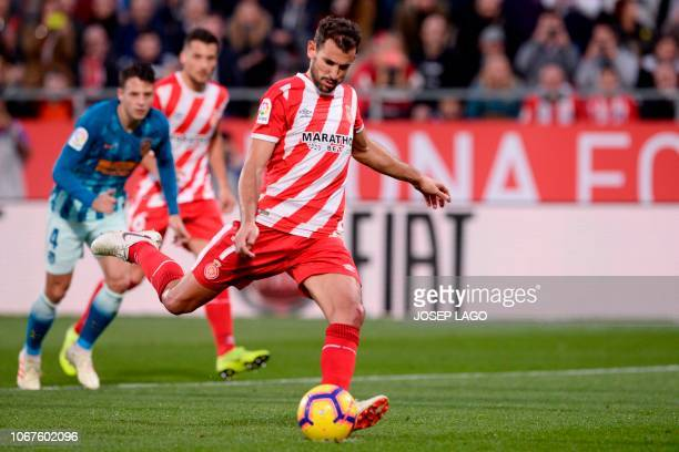 Girona's Uruguayan forward Cristhian Stuani scores a penalty during the Spanish league football match between Girona and Club Atletico de Madrid at...