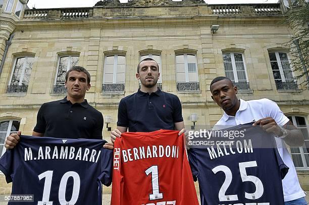 FC Girondins de Bordeaux's new Uruguayan midfielder Mauro Arambarri new goalkeeper Paul Bernardoni and new Brazilian forward Malcom pose after a...