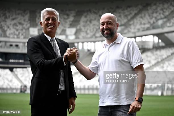Girondins de Bordeaux's newly appointed Bosnian-Swiss headcoach Vladimir Petkovic and Girondins de Bordeaux's president Gerard Lopez pose for...