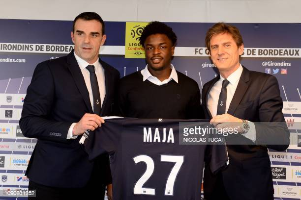 FC Girondins de Bordeaux's newly recruited player English forward Josh Maja poses with his new jersey next to Bordeaux's French president Frederic...