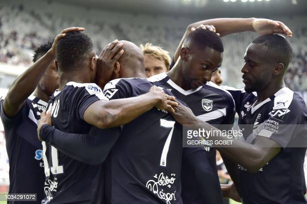 FC Girondins de Bordeaux's players celebrate after scoring during the French L1 football match between FC Girondins de Bordeaux and Nimes Olympique...