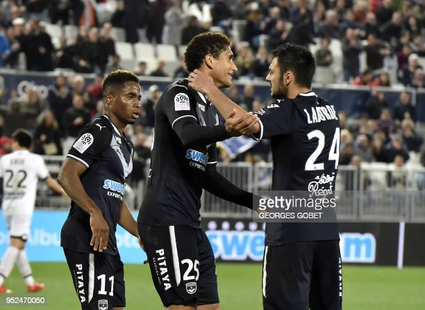 FC Girondins de Bordeaux's players celebrate after scoring during the French L1 football match between FC Girondins de Bordeaux and Dijon FCO on...