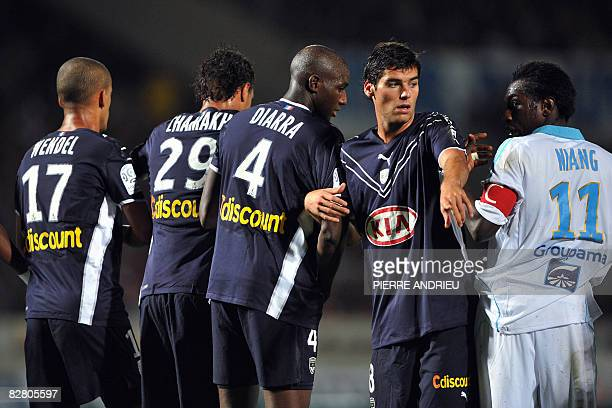 Girondin's mildfielder Yoann Gourcuff and Marseille's forward Mamadou Niang are pictured during a penalty shoot out during their French L1 football...