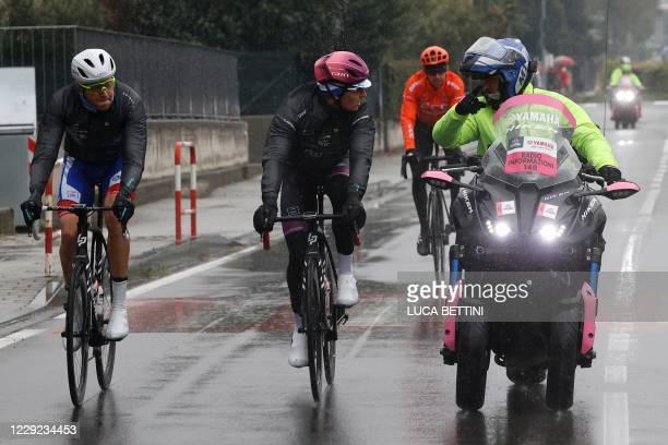 Giro's official regulators chat with Team Groupama-FDJ France's rider Arnaud Demare and other riders during the 19th stage of the Giro d'Italia 2020...
