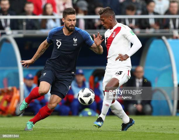 Giroud of France in action against Pedro Aquino of Peru during the 2018 FIFA World Cup Russia Group C match between France and Peru at the...