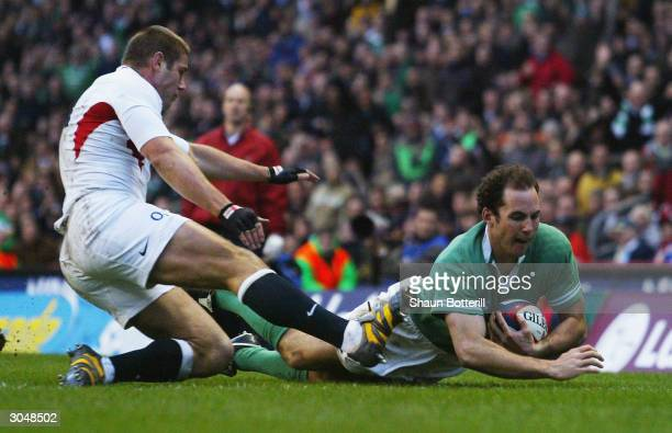 Girvan Dempsey of Ireland scores a try during the RBS Six Nations match between England and Ireland at Twickenham on March 6, 2004 in London.
