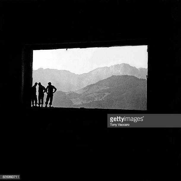 GIs in silhouette can be seen standing in the ruins of Hitler's mountain retreat the Berghof Obersalzberg Germany World War II June 1945