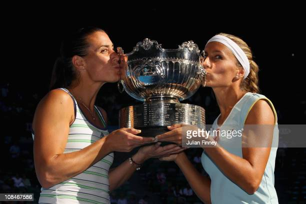 Gisela Dulko of Argentina and Flavia Pennetta of Italy kiss the trophy after winning the Women's doubles final match against Maria Kirilenko of...