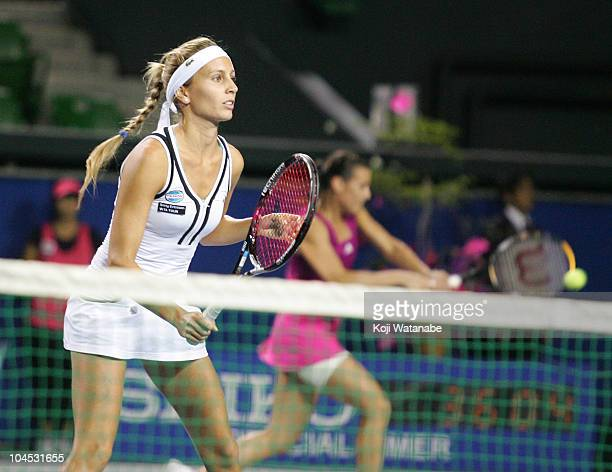 Gisela Dulko of Argentina and Flavia Pennetta of Italy return the ball against Kimiko Date Krumm and Ayumi Morita of Japan on day four of the Toray...