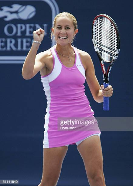 Gisela Dulko of Argentina celebrates as she plays against Elena Dementieva of Russia, during the second round of the Rogers Cup tennis on August 4,...