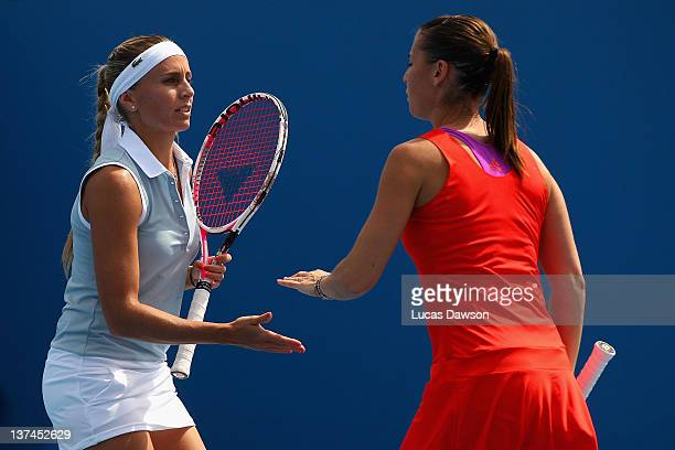 Gisela Dulko of Argentina celebrates with teammate Flavia Pennetta of Italy in their second round doubles match against Silvia Soler-Espinosa and...
