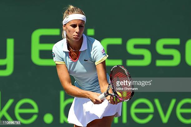 Gisela Dulko of Argentina gets set to serve against Elena Vesnina of Russia during the Sony Ericsson Open at Crandon Park Tennis Center on March 23,...