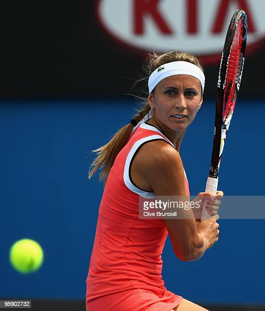Gisela Dulko of Argentina plays a backhand in her second round match against Ana Ivanovic of Serbia during day four of the 2010 Australian Open at...