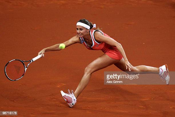 Gisela Dulko of Argentina plays a forehand during her first round match against Jelena Jankovic of Serbia at day three of the WTA Porsche Tennis...