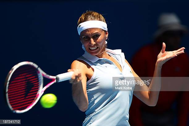 Gisela Dulko of Argentina plays a forehand in her first round match against Maria Sharapova of Russia during day two of the 2012 Australian Open at...