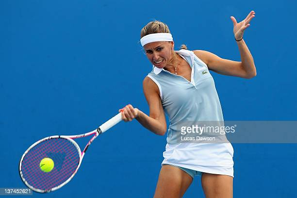 Gisela Dulko of Argentina plays a forehand in her second round doubles match with Flavia Pennetta of Italy against Silvia Soler-Espinosa and Carla...