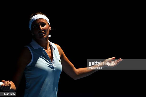 Gisela Dulko of Argentina reacts in her first round match against Maria Sharapova of Russia during day two of the 2012 Australian Open at Melbourne...