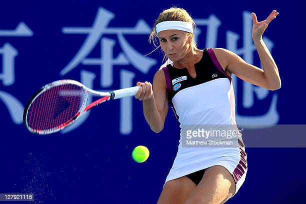Gisela Dulko of Argentina returns a shot to Virginie Razzano of France during the China Open at the National Tennis Center on October 3, 2011 in...