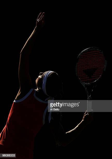 Gisela Dulko of Argentina serves against Marion Bartoli of France during day five of the 2010 Sony Ericsson Open at Crandon Park Tennis Center on...