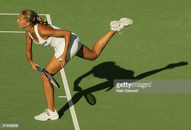 Gisela Dulko of Argentina serves in her match with Iveta Benesova of the Czech Republic during day five of the Moorilla International at the Domain...