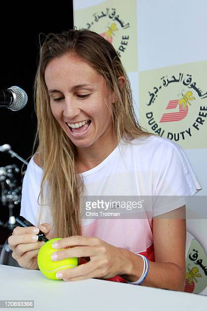 Gisela Dulko of Argentina, signs autograph for fans at the Rogers Cup presented by National Bank at the Rexall Centre on August 8, 2011 in Toronto,...