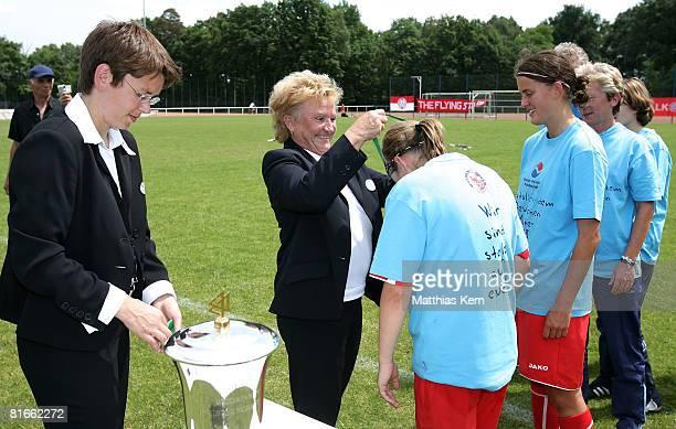 Gisela Gattringer of DFB congratulates MarieLouise Bagehorn of Potsdam after winning the Women B Juniors Final match between FFC Turbine Potsdam and...