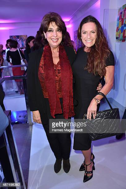 Gisela Gottlieb and actress Christine Neubauer during the 'Susanne Wiebe Fashion & Art Show' on September 9, 2015 in Munich, Germany.