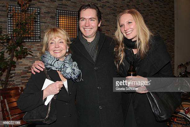 Gisela Schneeberger her son Philipp Schneeberger and his wife Martina attend the premiere of the film 'Und Aektschn' at City Kino on January 30 2014...