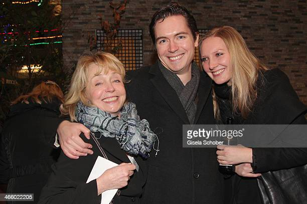 Gisela Schneeberger, her son Philipp Schneeberger and his wife Martina attend the premiere of the film 'Und Aektschn' at City Kino on January 30,...
