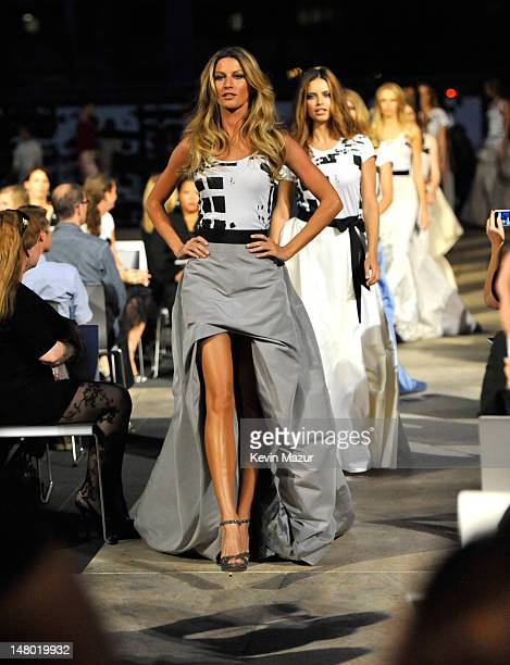 Gisele Bundchen and Adriana Lima walk the runway during Fashion's Night Out The Show at Lincoln Center on September 7 2010 in New York City