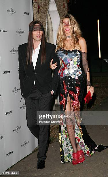 Gisele Bundchen and Alexis Roche during Moet Chandon Tribute to Nick Knight in London Arrivals October 24 2006 at Strawberry Hill House in London...