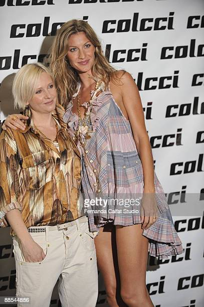 Gisele Bundchen and Jessica Lengyel pose for a photograf at Colcci during the first day of Sao Paulo Fashion Week SpringSummer 2010 collection at the...