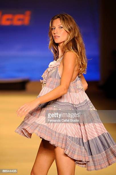 Gisele Bundchen displays a design by Colcci during the first day of Sao Paulo Fashion Week SpringSummer 2010 collection at the Bienal Pavilion in...