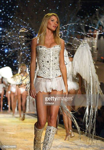 Gisele Bundchen during finale wearing custom embellished crystal corset white Victoria's Secret second skin satin bikini and short chiffon skirt in...